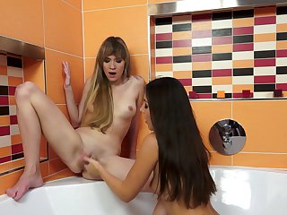 Brunette demonstrates body parts while getting her bush tongue fucked by Iwia in girl-on-girl action