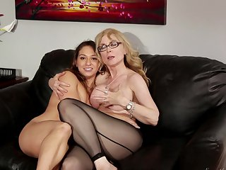 Blonde Aiden Starr is on the way to the height of pleasure with Nina Hartley's tongue in her fuck hole