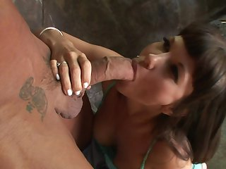 Brunette Carrie Ann with giant boobs polishing the pearl