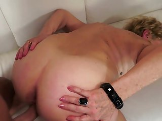 Blonde hooker with huge knockers enjoys erect tool in her mouth