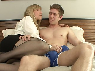 Danny Wylde uses his stiff meat pole to make blowjob addict Blonde Nina Hartley with giant hooters happy