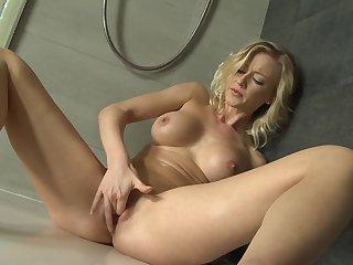 Blonde with juicy jugs groans as she dildos her wet spot