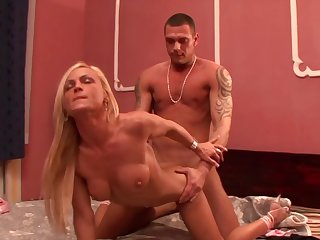 Blonde with huge breasts is ready to spend hours with dudes love wand in her mouth