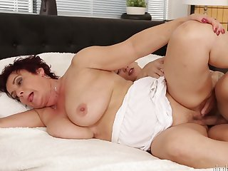 Brunette gets covered in cream after sex with horny man