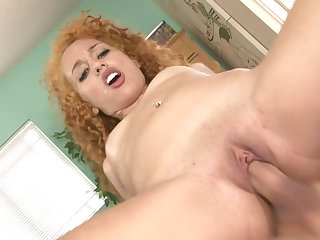 Redhead goddess gets her lovely face painted with man cream on cam for your viewing pleasure